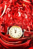 Christmas composition with red baubles and watch Royalty Free Stock Photos