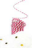 Christmas composition with red hemp ribbon, decorations, golden Royalty Free Stock Photos