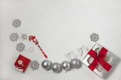 Christmas composition of red and silver decorations, gift box with ribbon bow, flatlay stock image