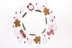 Christmas composition. Round frame made of decorations, fir tree branches, gingerbread man cookies on white background. Winter ho. Lidays concept. Flat lay, top royalty free stock photo