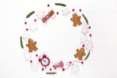 Christmas composition. Round frame made of decorations, fir tree branches, gingerbread man cookies on white background. Winter ho. Lidays concept. Flat lay, top royalty free stock images