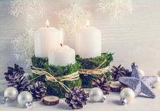 Christmas composition in the Scandinavian style. Candles, natural elements, rustic style. royalty free stock photography