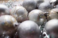 Christmas composition. Christmas silver balls decorations on white tinsel background. Close up. Christmas composition. Christmas silver balls decorations on royalty free stock image