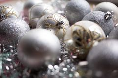 Christmas composition. Christmas silver balls decorations on white tinsel background. Close up. Christmas composition. Christmas silver balls decorations on stock images