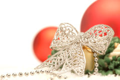 Christmas composition with silver bow and red balls Stock Photo