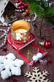 Christmas composition with sledges and a burning c Royalty Free Stock Images