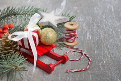 Christmas composition with sledges, fir branch, gift box Royalty Free Stock Photography