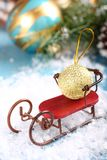 Christmas composition with sleigh and ball Royalty Free Stock Photo