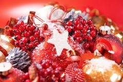 Christmas Composition with Snow and Berries Royalty Free Stock Images