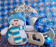 Christmas composition of a snowman and sled with decoration Royalty Free Stock Images