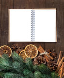Christmas composition with spices and notebook Stock Photos