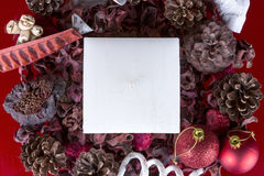 Christmas composition - square white candle Stock Image
