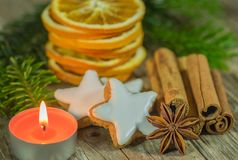 Christmas still life with star cookies, spices, orange slices and candlelight. Christmas composition of star biscuits, spices, orange slices and candle stock photo