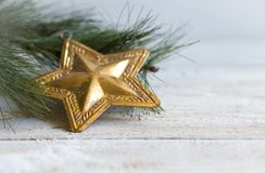 Christmas composition with star. On wooden background Royalty Free Stock Image