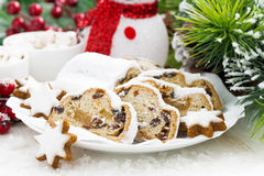 Christmas composition with Stollen, biscuits and snowman Royalty Free Stock Image