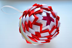 Christmas composition. Styrofoam ball decorated with satin ribbons. Handmade. Toy on the Christmas tree royalty free stock photo