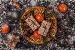 Christmas composition with tangerines, gift boxes, cones. Christmas composition with tangerines, gift boxes, cones on dark  background Royalty Free Stock Images