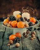 Christmas Composition with Tangerines, Pine cones, Walnuts Royalty Free Stock Images