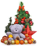 Christmas composition with teddy bear new year toys and trees Stock Images