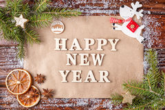 Christmas composition with text on paper happy new year in the center of the frame. Stock Images