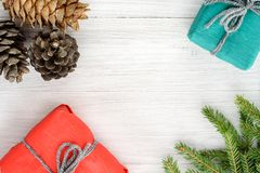 Christmas composition. Top view of gifts, cones and spruce branc Royalty Free Stock Image