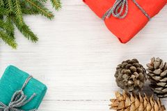 Christmas composition. Top view of gifts, cones and spruce branc Stock Photo