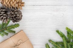 Christmas composition. Top view of gifts, cones and spruce branc Royalty Free Stock Photography