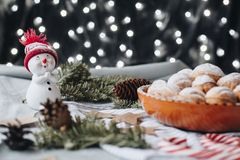 Christmas composition with a toy snowman, paper stars, cones, ch stock images