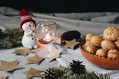 Christmas composition with a toy snowman, paper stars, cones, a stock images