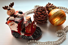 Christmas composition. Toy train carries Santa Claus on the occasion. Toys on the Christmas tree stock images