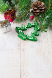 Christmas composition with toys and bells on light background. Selective focus. Stock Photos