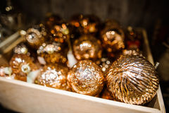 Christmas Composition with tree toys in box, gold balls Royalty Free Stock Photo