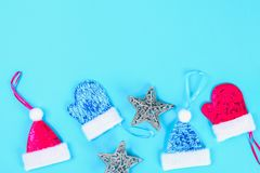 Christmas composition from Christmas tree toys. White decor on a blue background. Copy space, flat lay, top view. stock images