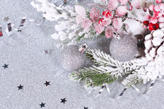 Christmas composition with two silver balls. Christmas composition with balls and fir branches on a silver background stock photos