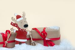 Wooden deer toy and gifts. Copy space. Christmas holiday background stock photography