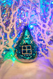 Christmas composition: Vintage glass tree toy house, twisting wh Royalty Free Stock Photography