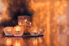 Christmas composition warm candles, dried oranges on table. Holiday, New Year, Christmas, cosiness concept. Cozy home royalty free stock images