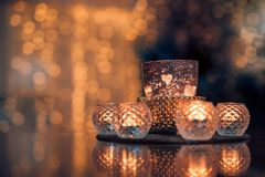 Christmas composition warm candles, dried oranges on table. Holiday, New Year, Christmas, cosiness concept. Cozy home stock photography