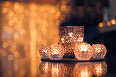 Christmas composition warm candles, dried oranges on table. Holiday, New Year, Christmas, cosiness concept. Cozy home stock photos