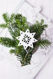 Christmas composition on a white background. Christmas tree branches and Christmas tree decoration star. Free space. Christmas composition on a white background Royalty Free Stock Photos