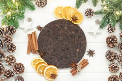 Christmas composition on a white background of Christmas decorat. Ions. Tree branches, cones, cinnamon sticks, star anise, dried oranges. Top view, flat lay Stock Photos