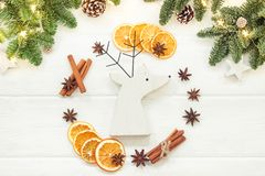 Christmas composition on a white background of Christmas decorat. Ions. Tree branches, cones, cinnamon sticks, star anise, dried oranges. Top view, flat lay Stock Photography