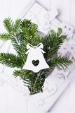 Christmas composition on a white background. Christmas tree branches and Christmas tree decoration bell. Free space. Christmas composition on a white background Royalty Free Stock Photos