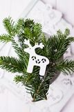 Christmas composition on a white background. Christmas tree branches and Christmas tree decoration deer. Free space. Christmas composition on a white background Royalty Free Stock Images