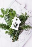 Christmas composition on a white background. Christmas tree branches and Christmas tree decoration hut. Free space. Christmas composition on a white background Royalty Free Stock Photos