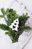 Christmas composition on a white background. Christmas tree branches and Christmas tree decoration. Free space. Christmas composition on a white background Royalty Free Stock Image