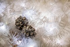 Christmas composition of white jewelry. Tinsel, cones, lanterns and candles. White Christmas snow. Shiny holiday decorations in wa stock images