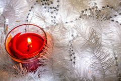 Christmas composition of white jewelry. Tinsel, cones, lanterns and candles. White Christmas snow. Shiny holiday decorations in wa stock image