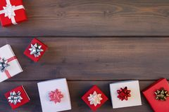 Christmas composition of white and red gift boxes with beautiful bows. Copy space. royalty free stock photos