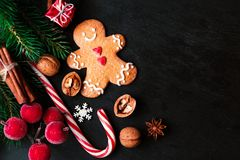 Free Christmas Composition With Christmas Gift, Gingerbread Man Cookie, Fir Tree Branches, Xmas Holiday Decorations Stock Image - 101812891